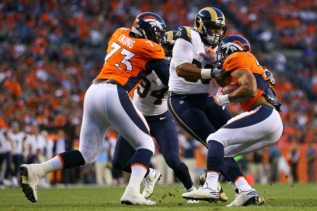 Russell Okung makes a block | Justin Edmonds/Getty Images