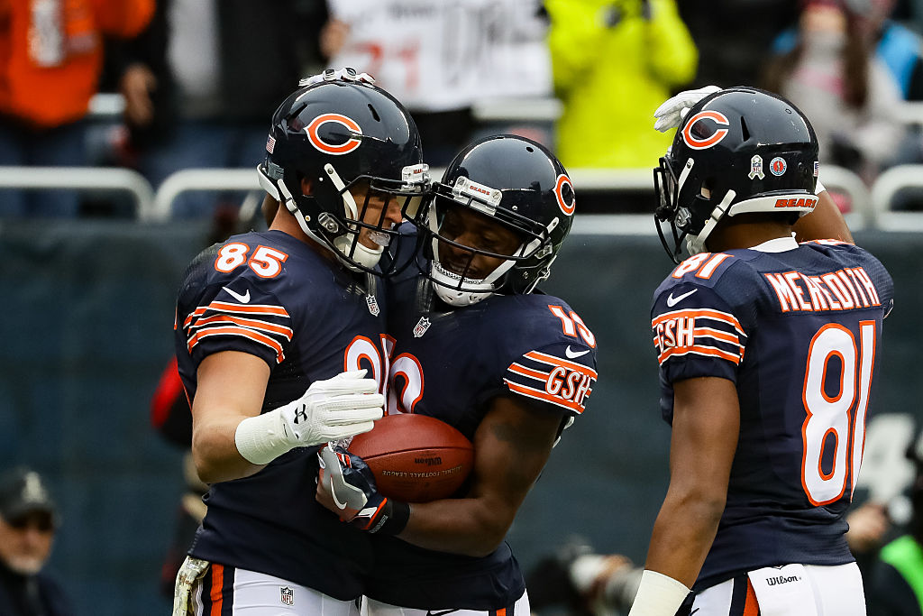 Daniel Brown of the Chicago Bears reacts with Eddie Royal after scoring.