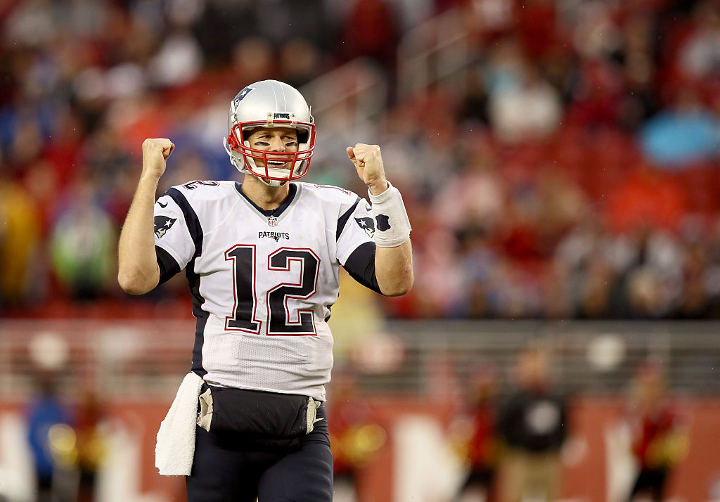 Tom Brady pumps his fist and reacts to scoring yet another touchdown.