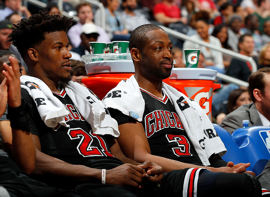 Jimmy Butler and Dwyane Wade of the Chicago Bulls look on from the bench.