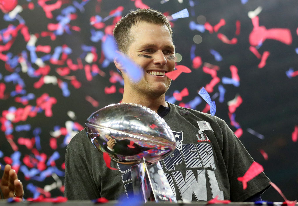 Tom Brady of the New England Patriots holds the Vince Lombardi Trophy after defeating the Atlanta Falcons 34-28 in overtime.
