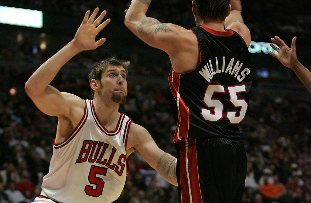 Andres Nocioni of the Chicago Bulls defends Jason Williams of the Miami Heat.