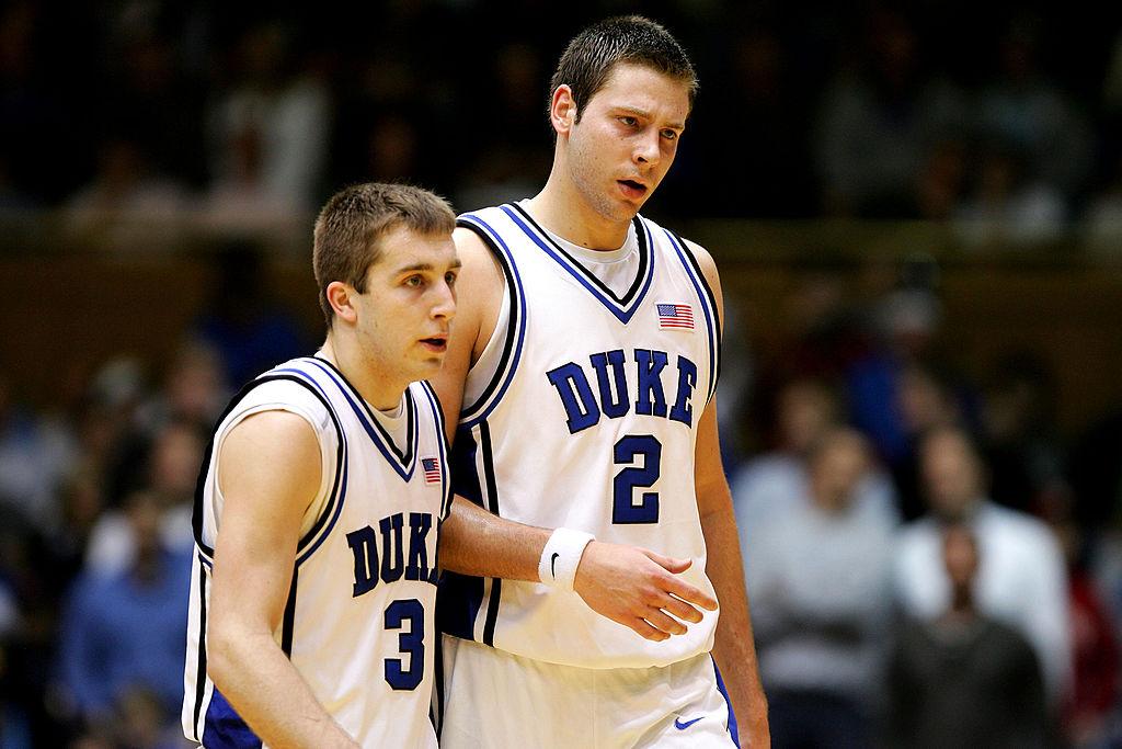 Josh McRoberts and teammate Greg Paulus of the Duke Blue Devils walk off the floor.
