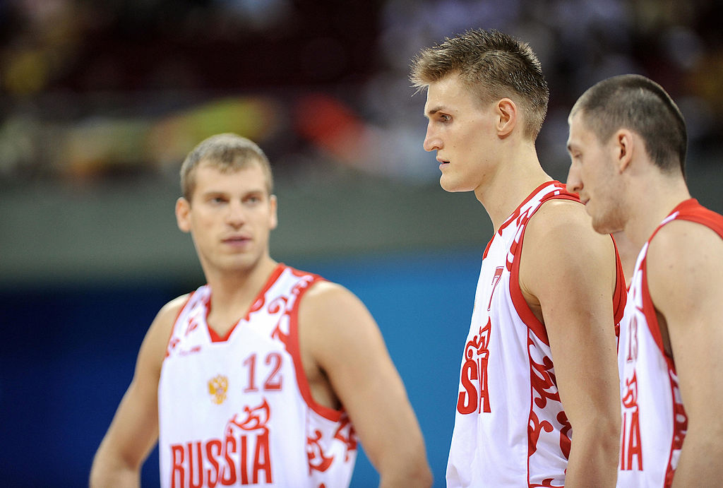 Russia's Sergey Monya, Andre Kirilenko, and Vitaly Frizon react during a men's basketball match against Australia.