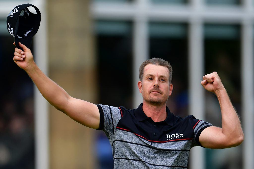 Henrik Stenson waves his hat at the crowd.