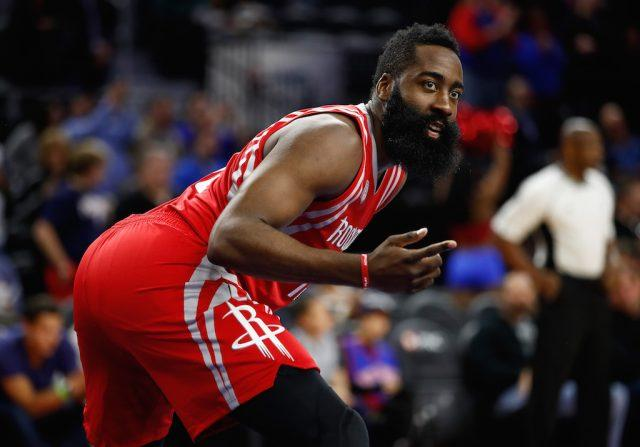 James Harden gestures to his teammates.