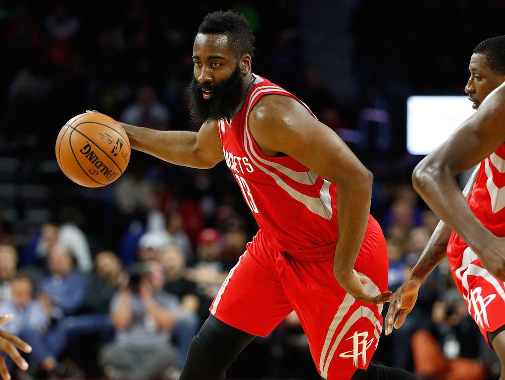 James Harden dribbles toward the basket.