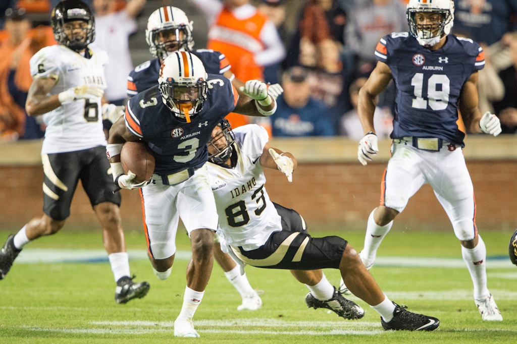 Auburn's Jonathan Jones dives into the end zone.