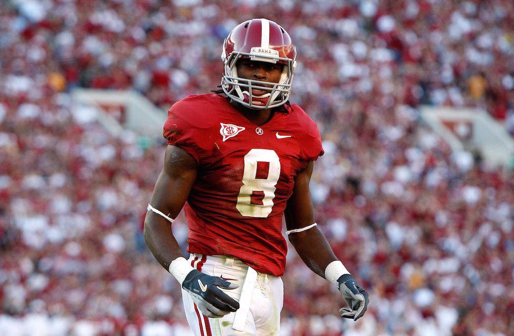 Alabama's Julio Jones walks across the field.