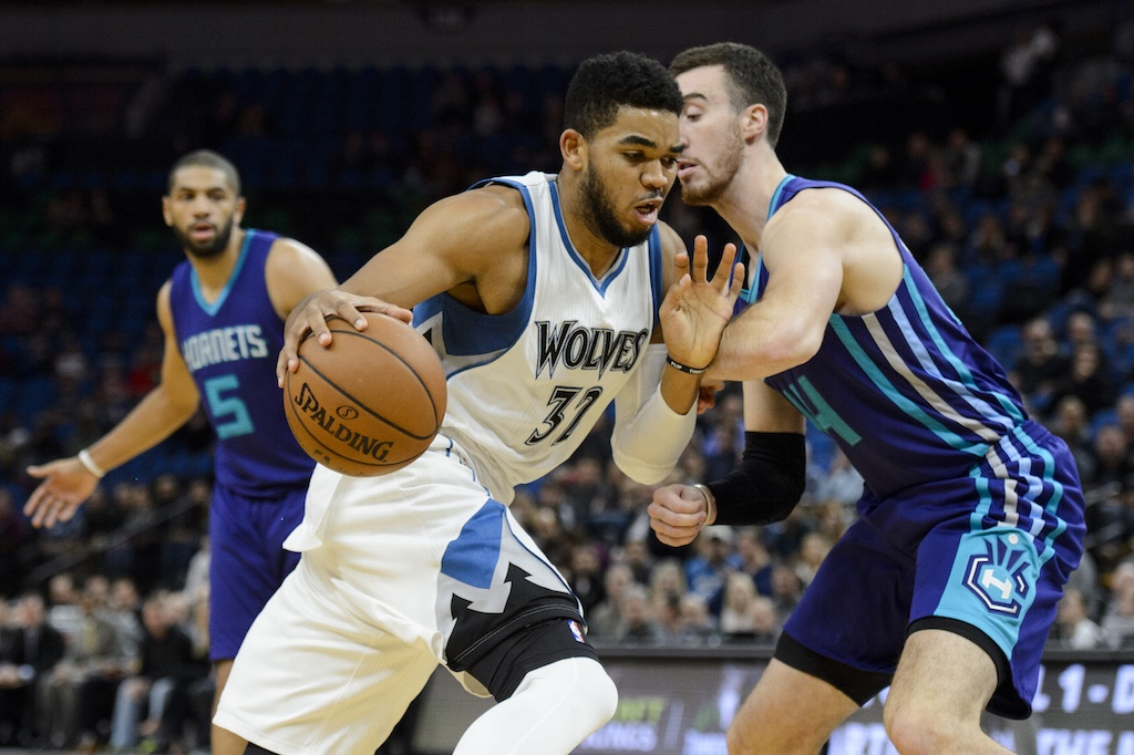 Karl-Anthony Towns dribbles to the basket.