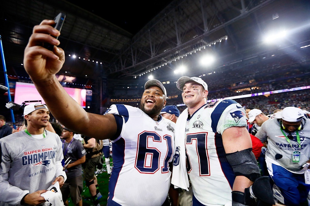 Marcus Cannon and Rob Gronkowski of the New England Patriots celebrate after winning Super Bowl XLIX.
