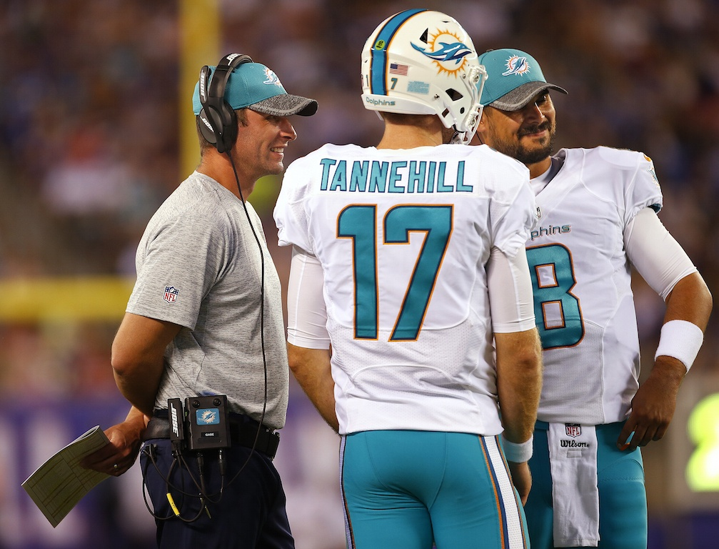Head coach Adam Gase of the Miami Dolphins talks with quarterbacks Ryan Tannehill #17 and Matt Moore #8.