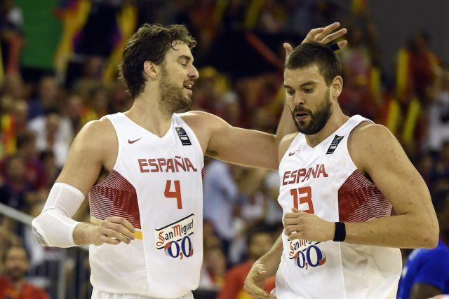 The Gasol brothers celebrate during a game for Spain.