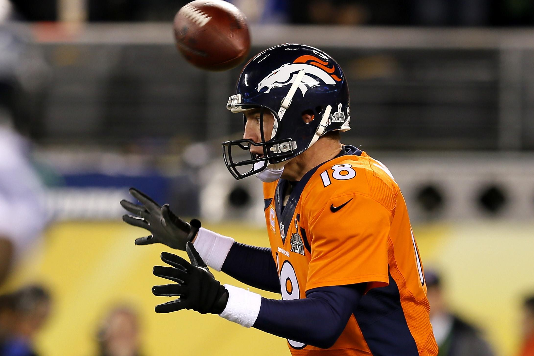 On the first play of Super Bowl XLVIII, the ball goes straight over Peyton Manning's head