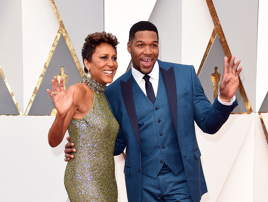 TV personalities Robin Roberts (L) and Michael Strahan attends the 88th Annual Academy Awards.