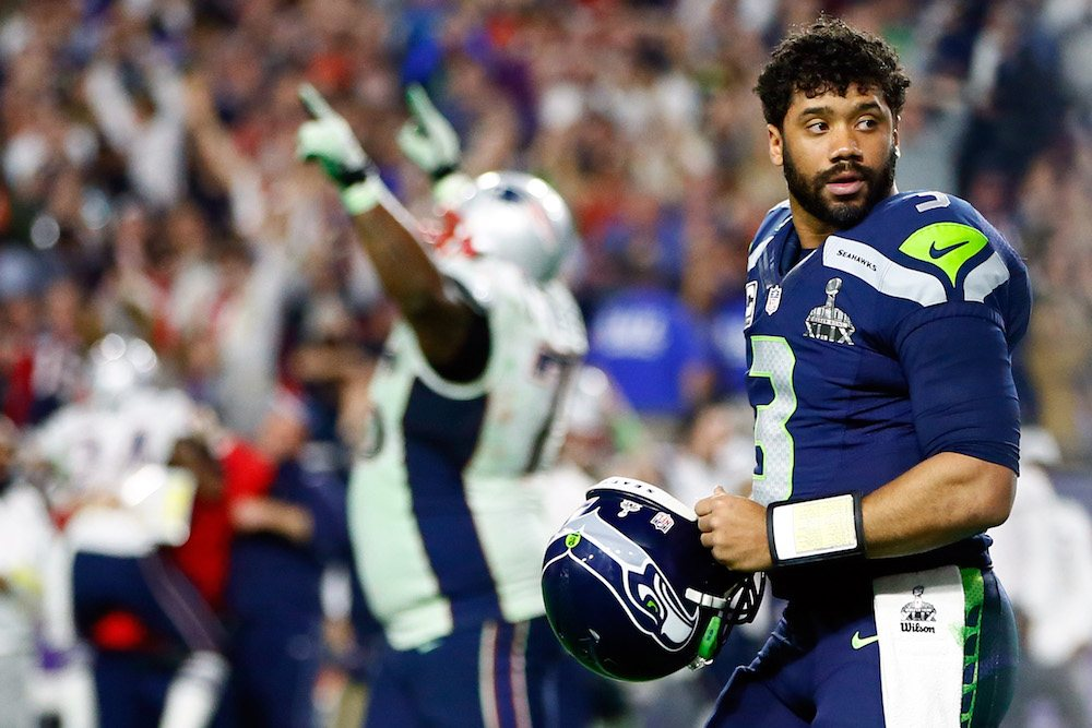 Russell Wilson looking on after a play