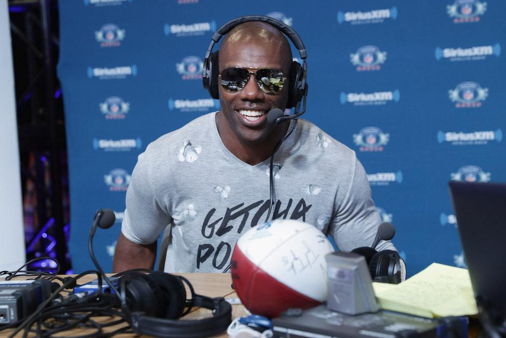 Terrell Owens speaks to the hosts during a radio show.