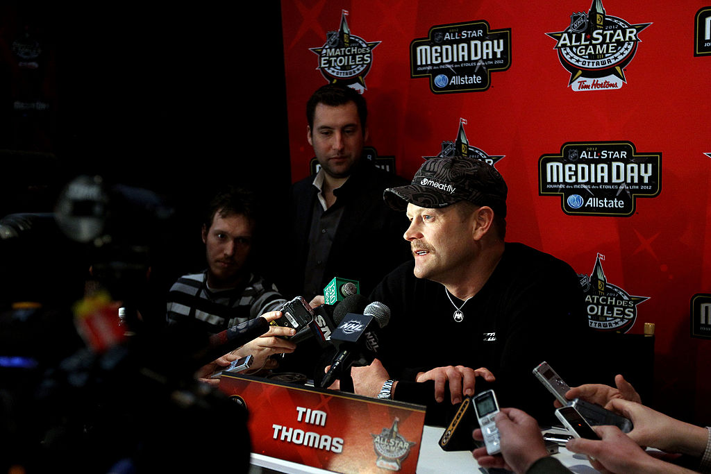 Goalie Tim Thomas of the Boston Bruins speaks with the press during the 2012 NHL All-Star Game media event.