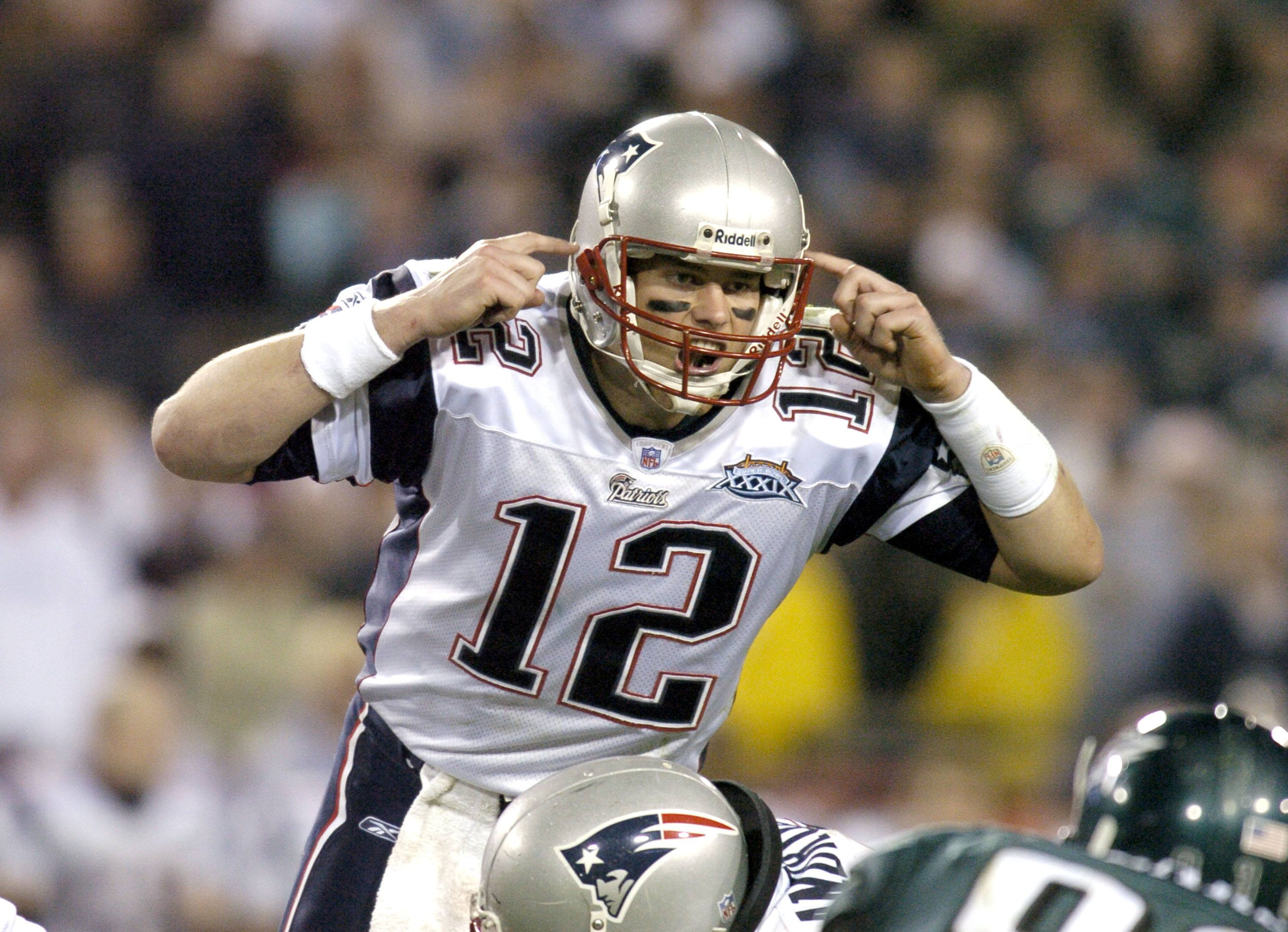 Tom Brady yells before beginning a play.