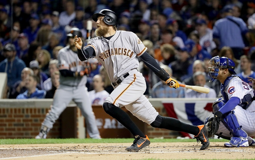 Hunter Pence hits a single in the second inning against the Chicago Cubs.