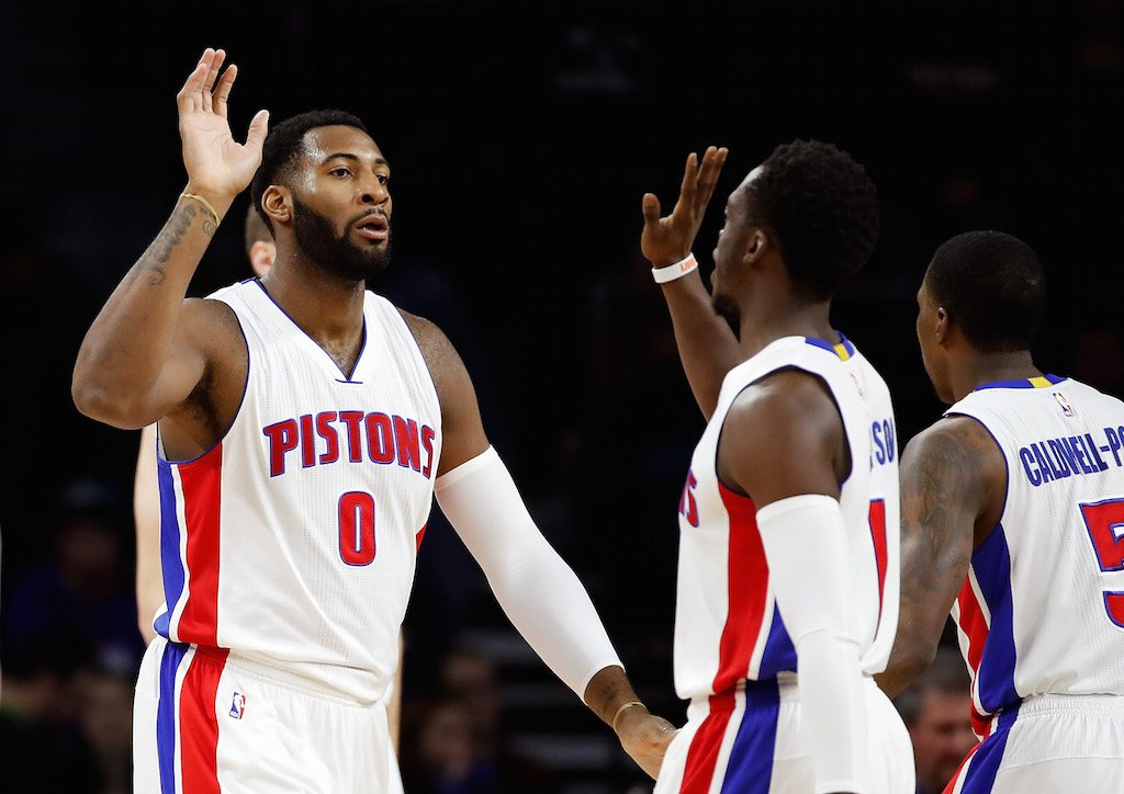 High-fives for Andre Drummond #0 and Reggie Jackson.