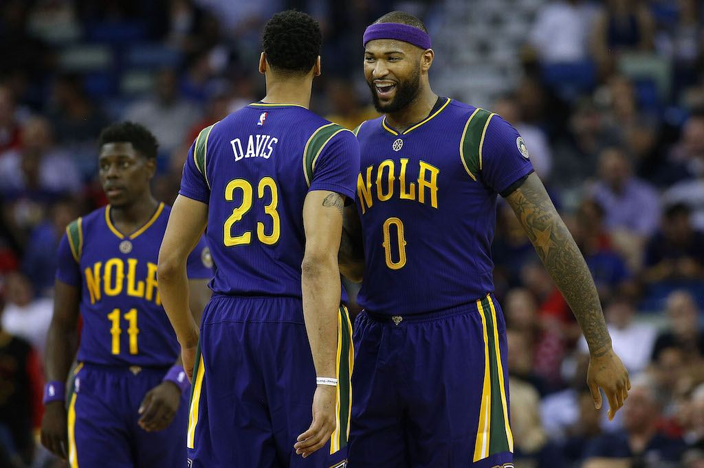Anthony Davis and DeMarcus Cousins celebrate during a game.