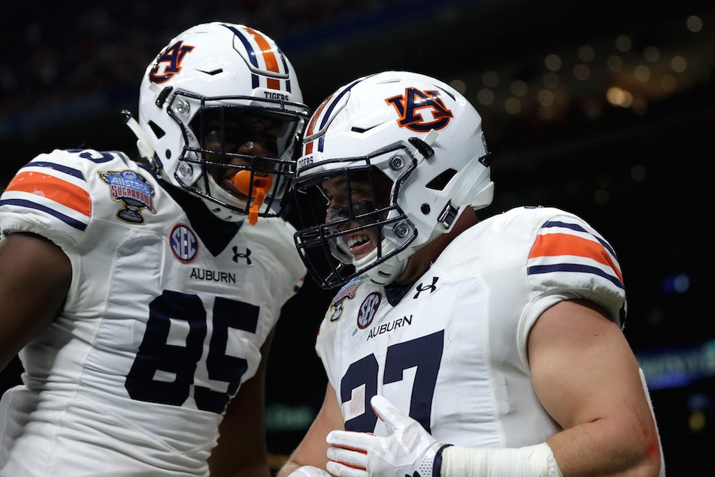The Auburn Tigers reacts after scoring a touchdown.