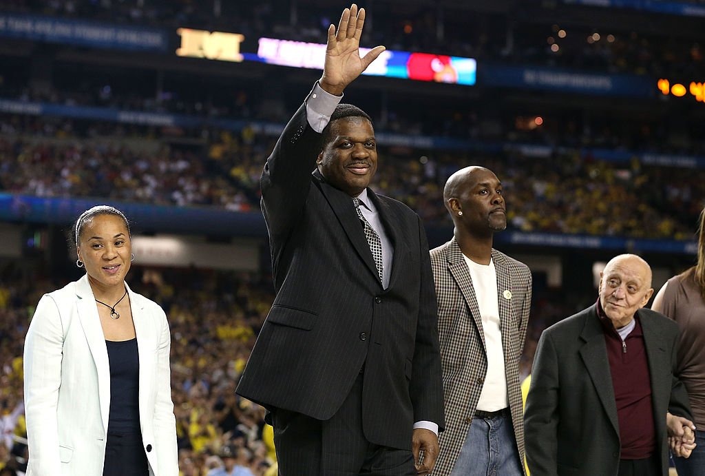 Class of 2013 Basketball Hall of Fame inductees (L-R) Dawn Staley, Bernard King, Gary Payton, and Jerry Tarkanian stand on the court.