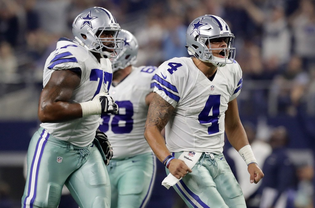 Dak Prescott celebrates after throwing a touchdown pass.