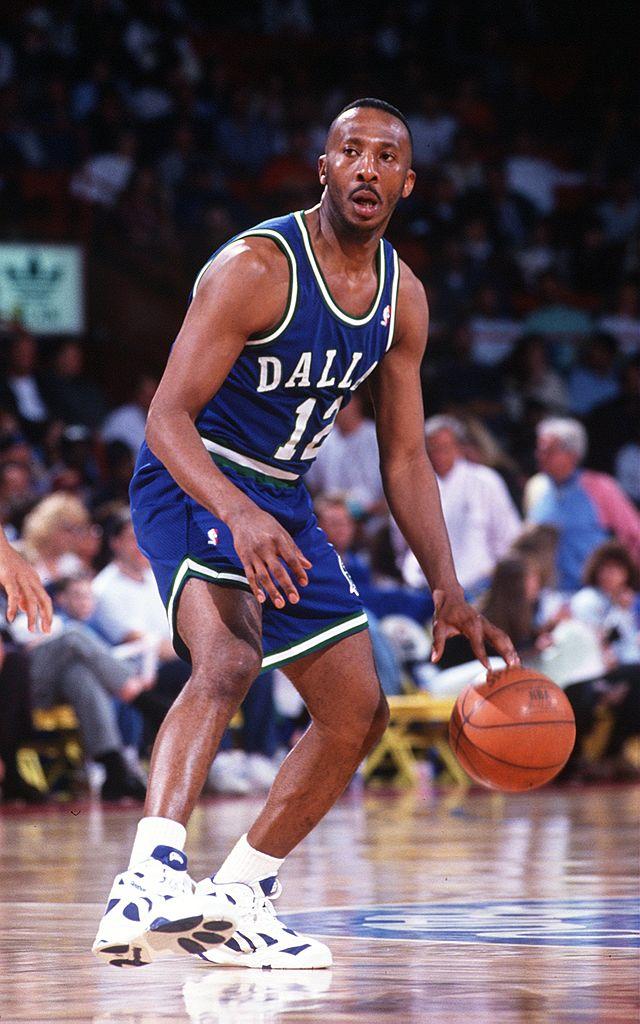 Dallas Mavericks guard Derek Harper dribbles the ball up-court during a game against the Denver Nuggets.