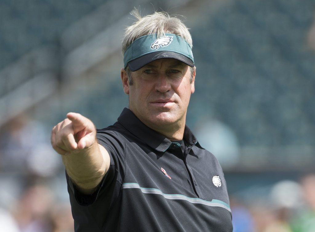 Doug Pederson points out at the field.