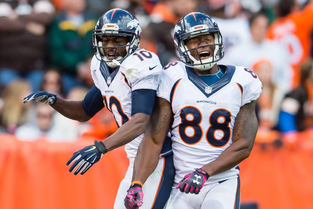 Emmanuel Sanders and Demaryius Thomas celebrate a win.