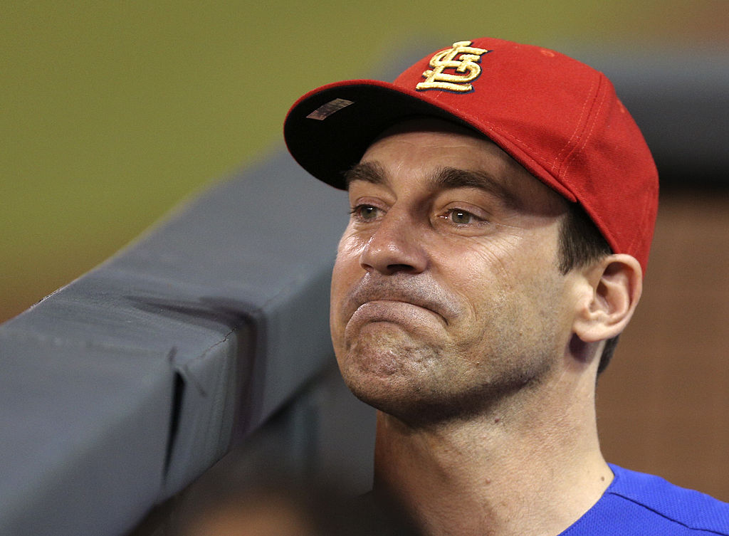 Actor Jon Hamm watches an interleague game between the St. Louis Cardinals and Kansas City Royals.
