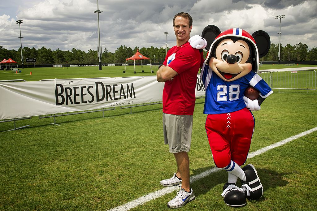 Brees poses with Mickey for his charity, The BreesDream Foundation