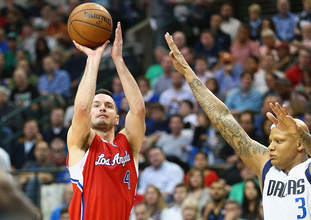 J.J. Redick of the Los Angeles Clippers takes a shot against Charlie Villanueva of the Dallas Mavericks.