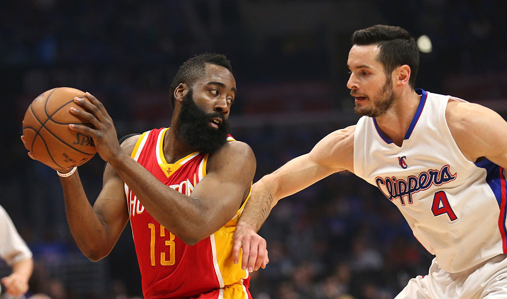 James Harden of the Houston Rockets controls the ball against J.J. Redick of the Los Angeles Clippers.