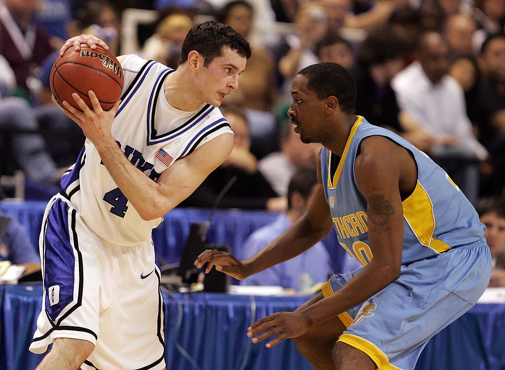J.J. Redick of the Duke Blue Devils is guarded by Alvin Mott of the Southern University Jaguars.
