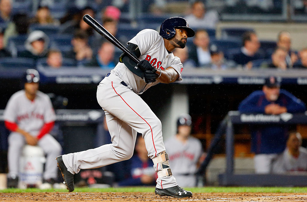 Jackie Bradley Jr. of the Boston Red Sox follows through on a second-inning single against the New York Yankees.