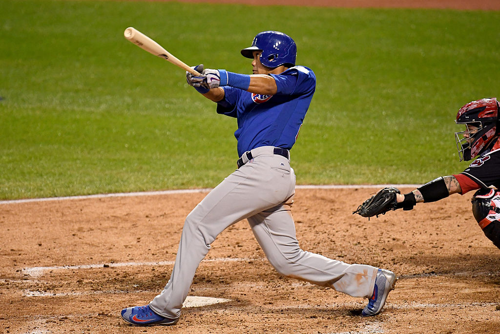 Addison Russell of the Chicago Cubs hits a grand slam home run against the Cleveland Indians in Game 6 of the 2016 World Series.