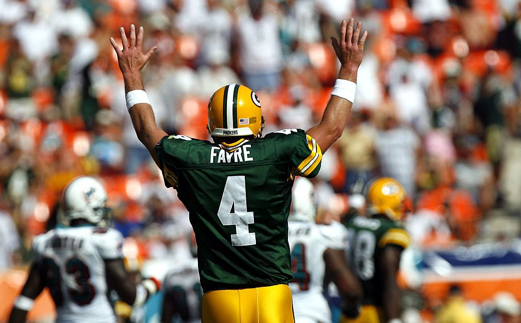 Quarterback Brett Favre of the Green Bay Packers celebrates a touchdown against the Miami Dolphins.