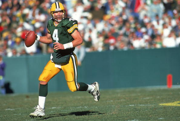 Brett Favre runs to pass the ball during a game against the Chicago Bears.