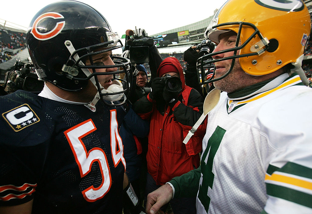 Brian Urlacher of the Chicago Bears talks with Brett Favre of the Green Bay Packers.