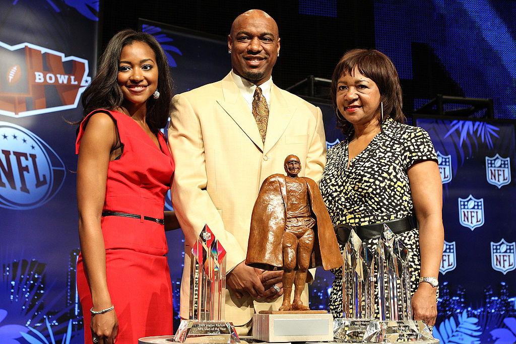 Walter Payton, and his wife and mom, attend the Walter Payton Man of the Year Press Conference.