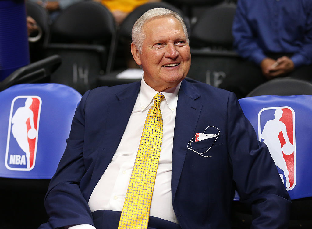 Golden State Warriors executive board member Jerry West sits on the bench before a game.