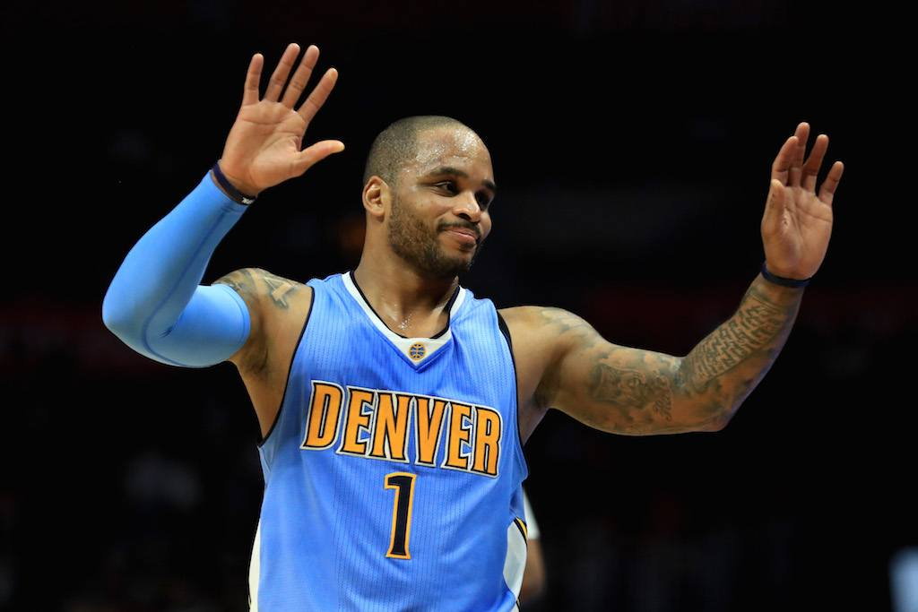 Jameer Nelson of the Denver Nuggets reacts to a foul.