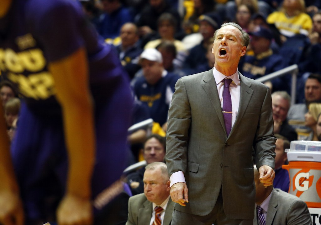 Jamie Dixon barks orders at his TCU players.