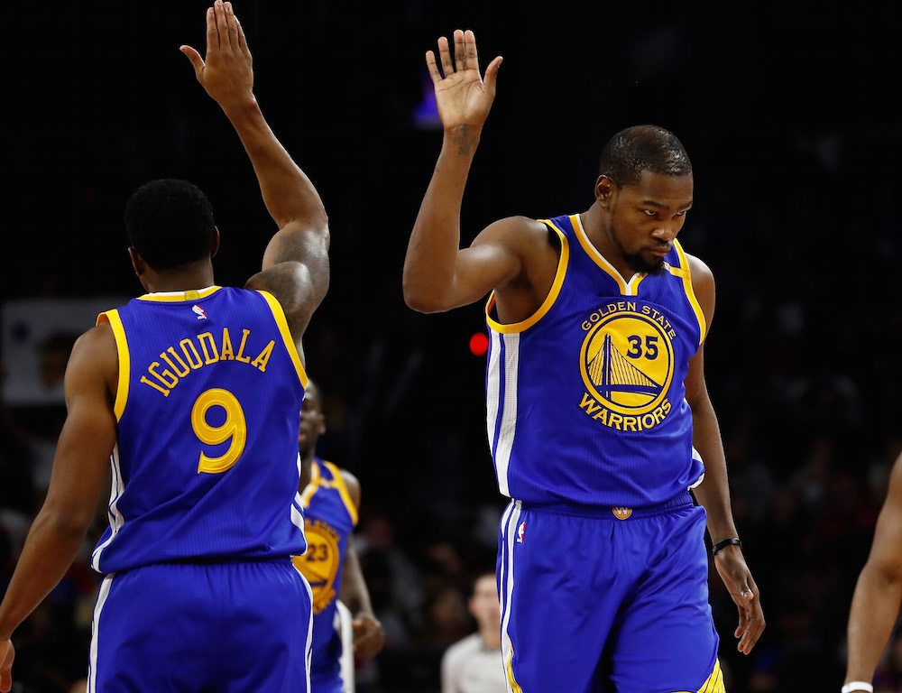 Kevin Durant of the Golden State Warriors celebrates a second half basket with Andre Iguodala.