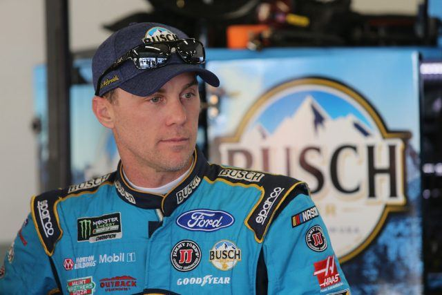 Kevin Harvick, driver of the #4 Busch Beer Ford, stands in the garage during practice.