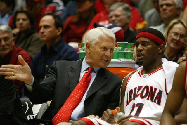 Head coach Lute Olson speaks with Hassan Adams of the Arizona Wildcats.