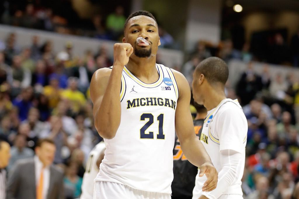 Michigan's Zak Irvin #21 pumps his fist.